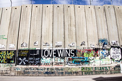 Barrier 4 - Love Wins (hjl) Tags: travel tower wall fence concrete graffiti israel palestine westbank politics protest middleeast security conflict barrier bethlehem tamron divide scorched 18270 pzd