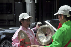 Culture clash (Roving I) Tags: costumes streets contrast events caps sydney parades lifestyle australia vehicles juxtaposition symbolism internationalwomensday eastmeetswest cultureclash convertiblecars chinesecymbals