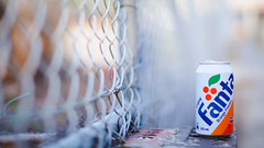 fanta [Explored] (SkyWalker108) Tags: orange brick metal fence cola drink bokeh can fanta