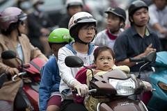 V057 Little girl thinker - Saigon (VesperTokyo) Tags: girl honda asia helmet mother scooter vietnam motorcycle saigon hochiminh 親子 ヘルメット オートバイ バイク スクーター 二人乗り nikond3 ノーヘル overloadedmotorcycle 三人乗り 四人乗り