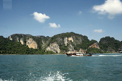 Krabi (desomnis) Tags: travel sea cliff holiday clouds thailand island islands boat limestone traveling krabi railay railaybeach limestonecliffs