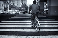 crosswalk with bike (bryan-roos) Tags: china blackandwhite bw man rain bike blackwhite shanghai sony   crosswalk nex7 sonynex7 bryanroos bryanroosimaging