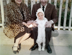 1961 - Mom real leopard coat, me and dad. (Whiskeygonebad) Tags: family winter baby love home me fence mom relax parents early hoodie 60s toddler dad coat sunny leopard sit care stoop nurture 1961
