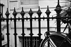 """Cute Bikes Chained to Fences in London"" (oh it's amanda) Tags: uk england blackandwhite bw london bike bicycle blackwhite blog blogged kodakbw400cn pushprocessed nikonem londonengland nikkor24mm28 nikkor2428 shotat1600"