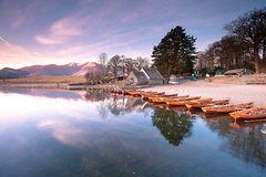 Shore Reflections (PeterYoung1.) Tags: uk england nature beautiful clouds reflections boat lakedistrict scenic derwentwater keswick