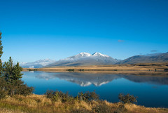 Dusting of Snow (Jocey K) Tags: morning trees newzealand sky plants cloud lake snow mountains water clouds reflections canterbury hills nz southisland lakeclearwater