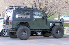 Cool Jeep (Eyellgeteven) Tags: green big jeep 4x4 modified chrysler mopar suv unlimited tj madeinusa americanmade fourwheeldrive lifted bigtires rockcrawler superswamper rollcage eyellgeteven
