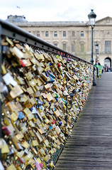 "Pont des Arts ""Lover's bridge"" (N Ackers) Tags: street city travel bridge blur paris fence outside outdoors dof bokeh lock couples ground locks railing brass padlock pontdesarts loversbridge whatanoppportunity itsrathercool"