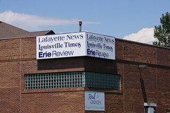 The Local News (Let Ideas Compete) Tags: sign officebuilding corner brick newspapers pregnancycarecenter