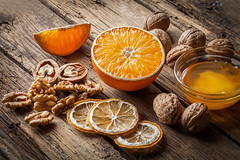 Walnut kernels and whole walnuts with orange (igorpalamarchuk) Tags: walnuts walnut background wooden rustic food old nature closeup wood healthy natural shell table brown health vintage season fruit nutshell group organic snack ingredient open raw nut orange candiedfruit