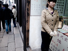 girl working at a gift shop (-{ ThusOriginal }-) Tags: 2009 china color digital giftshop grd3 grdiii people ricoh street thusihaveseen winter woman wuzhen