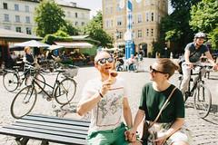 Ice it together (Yuliya Bahr) Tags: bike bicycle ice icecream happy summer sun august munich mnchen germany deutschland city smile engagement love together green yellow sunglasses redhead beart noon daylight sunlight hochzeitsfotografmnchen hochzeitsfotografbayern hochzeitsfotograftirol hochzeitsfotografstuttgart hochzeitsfotografberlin hochzeitsfotografleipzig hochzeitsfotografhamburg