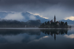 where the lord lives (nils_P) Tags: fog mist castle rocks clouds water lake morning reflection trees church