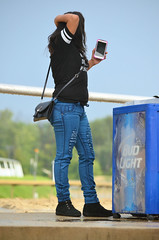 201608-21 (24) r8 woman by the rail at Laurel Park (JLeeFleenor) Tags: photos photography md marylandhorseracing maryland marylandracing laurelpark outside outdoors girls woman femme frau vrouw donna lamujer dona    ena kvinde nainen   n  wanita   kvinne  kobieta mulher  kvinna  kadn  ngiphn boots shoes footwear footgear tightjeans jeans connected purse