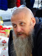 Beard (Sergey Skleznev) Tags: portrait man beard look eyes smile haircut eyewear seller talk fleamarket nikon coolpix p7800 moscow russia