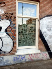 The Cosy House (Quetzalcoatl002) Tags: window graffity graffiti wall reflection street amsterdam