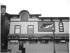 The Chance ([jonrev]) Tags: camera white black film monochrome bar last speed vintage polaroid restaurant illinois closed downtown fuji empty 420 grill vacant land 70s instant c