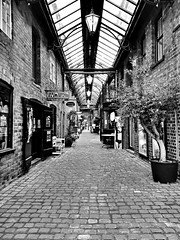 Getcliffes Yard - Leek [Over 9000 views! Thank you!] (Raven Photography by Jenna Goodwin) Tags: blackandwhite tree mobile shopping photography alley industrial factory phone cobbled shops converted stable leek staffordshire hdr streetscenes stables yark flickrfriday flickrandroidapp:filter=none getcliffes