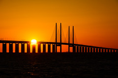 Burning bridge (Fredde Nilsson) Tags: bridge sunset orange sun black water silhouette y