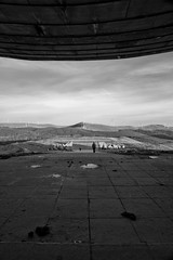 Gathering Storm (The New Motive Power) Tags: blackandwhite mountain mountains abandoned monument architecture concrete countryside moody silent view decay empty entrance dramatic peak structure historic communist bulgaria massive soviet vista socialist disused range derelict deserted isolated brutalist crumbling shipka balkan moderism staraplanina  betonbrut buzludzha canon7d