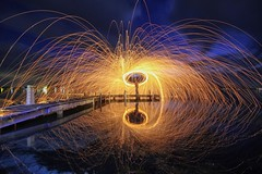 Splat (pominoz) Tags: lake reflection clouds fire belmont nsw sparks lakemacquarie steelwool wirewool