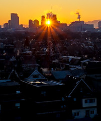 Urban Sunburst (roymondus) Tags: city light urban toronto industry sunrise downtown industrial ray smoke sony steam smokestack sunburst industrialization slta37