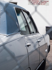 Four Door (Chosen at Random) Tags: car fence gray 98 m42 manualfocus oldsmobile helios ninetyeight e420