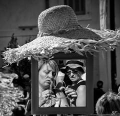 The choice! (poupette1957) Tags: art atmosphre black canon city curious detail french humanisme hat market life lady monochrome noiretblanc photographie people portrait reflet reflexion street shop town travel