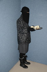 Slave Maid (Buses,Trains and Fetish) Tags: slave torture girl niqab hijab burka chador sweat waitress maid fur anorak coat winter warm apron