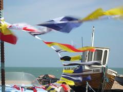Walmer, Kent (jcbkk1956) Tags: viagginelmondo blowing fluttering flags wind boats seaside beach coolpix nikon deal kent walmer boat pennants