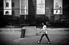 Buildings Reflected (stimpsonjake) Tags: nikoncoolpixa 185mm streetphotography bucharest romania city candid blackandwhite bw monochrome buildings architecture reflections woman walking