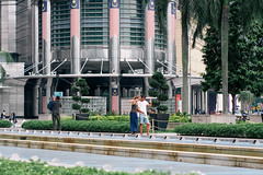 (yangkuo) Tags: klcc latemorning malaysia kualalumpur nationalflag merdeka vsign posing tourist petronas twintowers stick wefie couple smile