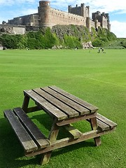 picnic table...........oh and bamburgh castle (Mr Ian Lamb) Tags: picnictable table seat bamburgh castle bamburghcastle northumberland