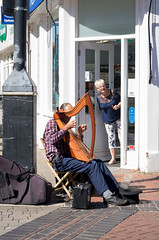 Do I hear the sound of angels? (sasastro) Tags: streetphotography busker harp harpist people