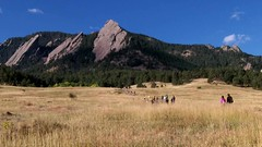 Walking the Chautauqua Trail, a popular outdoor activity in Boulder, Colorado (lhboudreau) Tags: flatirons boulder colorado theflatirons thefirstandsecondflatirons trail path grass grasses monolith monoliths rock rocks stone stones fence grassland outdoor outdoors landscape landscapes green trees hill hillside people hike hiking walking walk woodfence iconic hikers foothills rockface rockfaces field foothill mountain mountains video