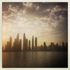 Dubai Marina sunrise (sonofwalrus) Tags:   silhouettes architecture buildings ocean sea water sunrise unitedarabemirates uae marina iphone hipstamatic dubai