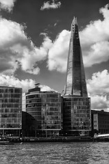 head in the clouds - HMM! (lunaryuna) Tags: uk england london metropolis urbanlandscape river thames buildings modernarchitecture rivershore theshard skyscraper urbansky clouds cloudscape lunaryuna blackwhite bw monochrome