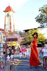 Fire Lady (lukegavin47) Tags: clocktower clock summer trees running roundabout lady fire costume stilts kids races people townhall sandgate colour crowd sunsetrun street flamelady firelady