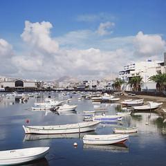 (MLO) Tags: city sea mountain 120 6x6 film analog rolleiflex mediumformat square boats spain fuji lanzarote 120film pro planar arrecife carlzeiss 35f rolleiflex35f 75mmf35 160ns mittleformat