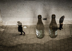 Message In A Bottle (petertandlund) Tags: street city people urban woman man color beer girl bottle sweden stockholm doubleexposure streetphotography surreal dreamy sthlm londoncalling multiexposure pavingstones flickrfriday peopleinmotion xe1 fujix