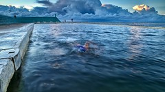 Seeing Blue (Peter Knott) Tags: ocean morning blue cloud water clouds swimming dawn australia olympus baths nsw swimmer nik e3 zuiko gitzo zd 1260mm rrsbh40 newcastlesundance gt2542l