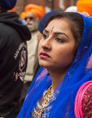 A spectator at the 2013 Sikh Vaisakhi festival parade in Southampton (Anguskirk) Tags: uk england color colour festival hampshire procession sikh gurdwara southampton turbans saris vaisakhi nagarkirtan