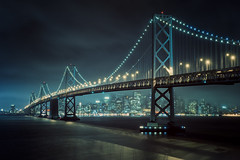 Bay Lights (Allard Schager) Tags: sf sanfrancisco california city longexposure nightphotography bridge usa mist fog skyline architecture america 1936 spring nikon downtown skyscrapers nightshot unitedstatesofamerica towers landmark icon illuminated f16 le baybridge bayarea april vista sanfranciscobay curve curved amerika lente iconic span westbound gettyimages californie vantagepoint interstate80 yerbabuenaisland customwhitebalance tollbridge 15s sanfranciscooaklandbaybridge 100faves 2013 62mm singleraw d700 nikond700 nikkor2470mmf28 nikonfx allardone allard1 baylights detailextractor allardschagercom