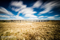 Wider than the Sky (Aaron Yeoman [Old Account]) Tags: uk longexposure greatbritain travel bridge england sky cloud motion brick art grass lines stone architecture clouds rural movement flora europe arch unitedkingdom stonework yorkshire bricks curves masonry victorian railway arches line valley slowshutter gb moors curve moor vignetting vignette railwayline northyorkshire a77 ribbleheadviaduct ribblehead settlecarlislerailway chapelledale nd110 johnsydneycrossley sigma1020mm1456exdchsm sonya77 lee09ndgrad leebigstopper slta77 sonyalphaslta77