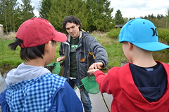 Jason letting kids gently hold Pacific Chorus Frogs. (BCWF Wetlands Education Program) Tags: bc conservation environmental environment restoration langley wetland arbourday citizenscience bcwf townshipoflangley langleyenvironmentalpartnerssociety wetlandseducationprogram