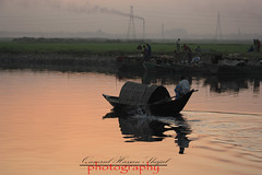 Boat Man1 (Shajal1) Tags: life sunset red portrait sky cloud white color reflection nature water beautiful beauty yellow closeup canon wonderful river dark lens landscape photography eos golden evening boat amazing colorful dof shot samsung 300mm 55mm disk dell excellent hassan dhaka bangladesh core 75mm supershot 70mm300mm canon60d shajal canoneos60d blinkagain gettyimagesbangladeshq12012 qamrul qamrulhassanshajal eveningboatman