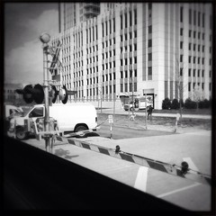 Crossing in River East (smaedli) Tags: railroad bw chicago iphone uploaded:by=flickrmobile flickriosapp:filter=nofilter