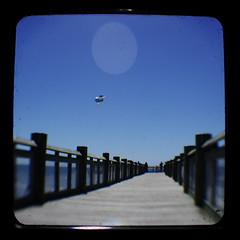 Kite over pier (Area Bridges) Tags: kite beach pentax kodak may bluesky kites milford duaflex skyblue k5 walnutbeach duaflexiv kitefly ttv 2013 throughtheviewfinder may2013 milfordliving may42013 20130504