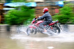 On a rainy day (splashed) (BACHCHA POLAPINE) Tags: green water rain bike speed day helmet rainy motor dhaka splash bangladesh motijheel d300s 1685mm