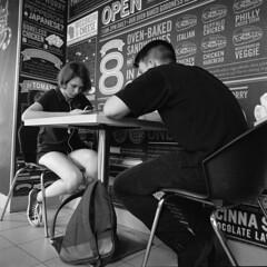 In a pizzeria. Moscow. 08.2016 (Woodent) Tags: streetphotography mediumformat 6x6 moscow film bw kodaktrix400 hasselblad503cx carlzeissdistagon504 diafine 800 pizzeria